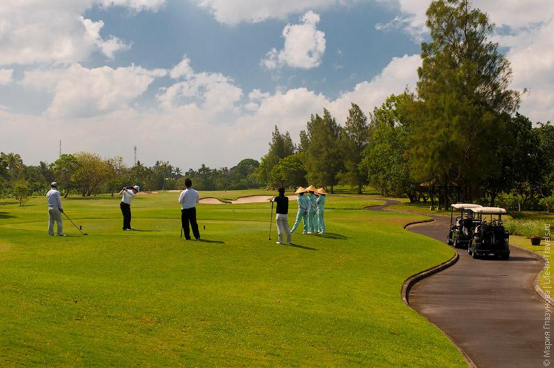 Игроки в гольф